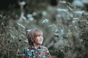 boy in nature enjoying outdoor learning