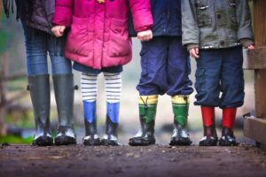 children wearing wellies for outdoor learning